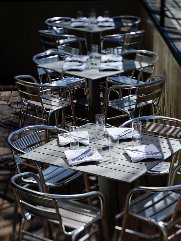 . DENVER, CO - APRIL 21:  Patio tables at Grind Kitchen + Watering Hole in Cherry Creek North  in Denver on Thursday, April 21, 2016. Grind is located at 300 Fillmore. (Photo by Cyrus McCrimmon/ The Denver Post)