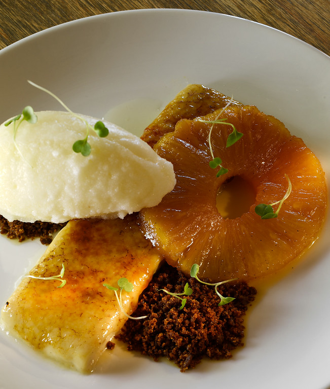 . DENVER, CO - APRIL 21:  Pastry chef Claire Fields\'   Smokejumper Ginger Tea Creme Brûlée with caramelized pineapple, pineapple-brandy sorbet and ginger snap crumble at Grind Kitchen + Watering Hole in Cherry Creek North  in Denver on Thursday, April 21, 2016. (Photo by Cyrus McCrimmon/ The Denver Post)
