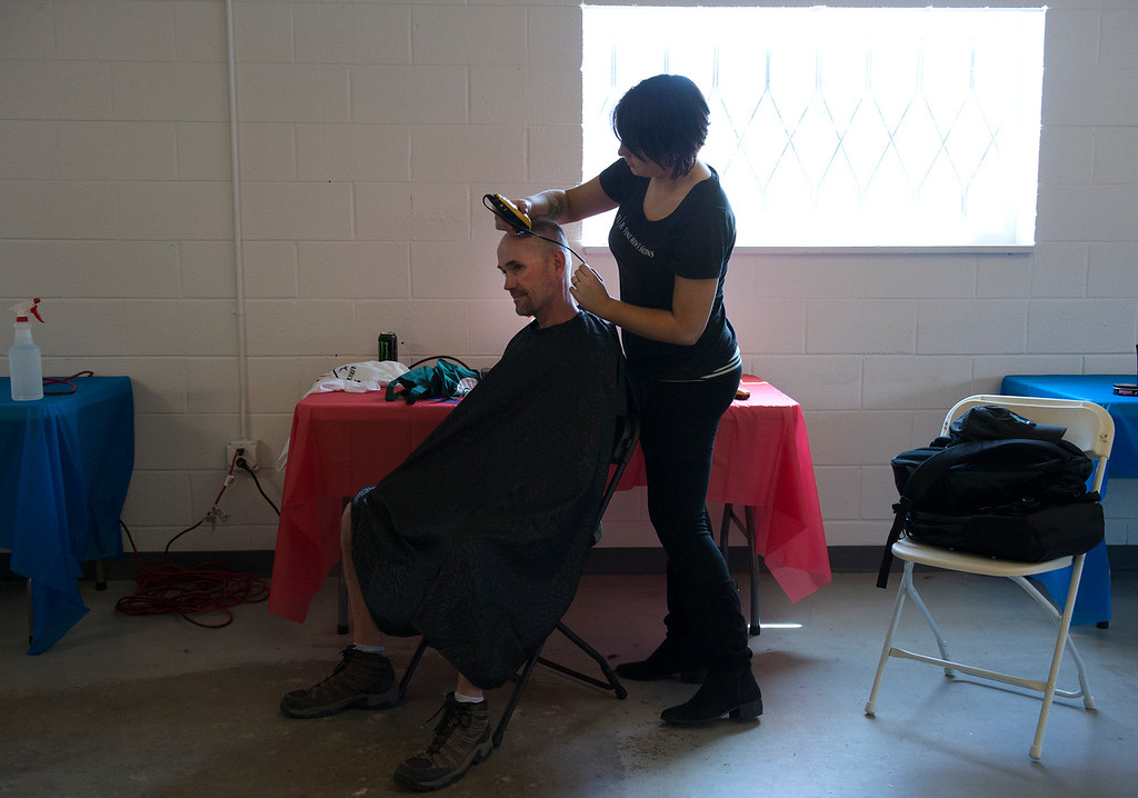 """. DENVER, CO - APRIL 25: Donating her time, Nicky Choromanski, right, gives Army veteran Rock Moore his haircut. Volunteers of America along with other organizations, hosts a \""""Haircuts for Veterans\"""" event at the Bill Daniels Veteran Service Center in Denver on Monday, April 25, 2016. Along with the haircuts, veterans have access to housing service assistance, assistance with job and education opportunities, as well as a hot meal. (Photo by Kathryn Scott Osler/The Denver Post)"""