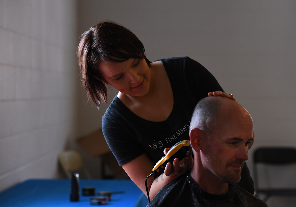 """. DENVER, CO - APRIL 25: Donating her time, Nicky Choromanski, left, gives Army veteran Rock Moore his haircut. Volunteers of America along with other organizations, hosts a \""""Haircuts for Veterans\"""" event at the Bill Daniels Veteran Service Center in Denver on Monday, April 25, 2016. Along with the haircuts, veterans have access to housing service assistance, assistance with job and education opportunities, as well as a hot meal. (Photo by Kathryn Scott Osler/The Denver Post)"""