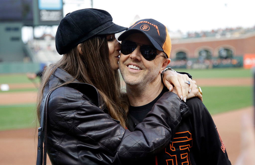 . entMetallica\'s Lars Ulrich, right, gets a kiss from his wife Jessica Miller before a baseball game between the San Francisco Giants and Colorado Rockies Friday, May 6, 2016, in San Francisco. (AP Photo/Marcio Jose Sanchez)