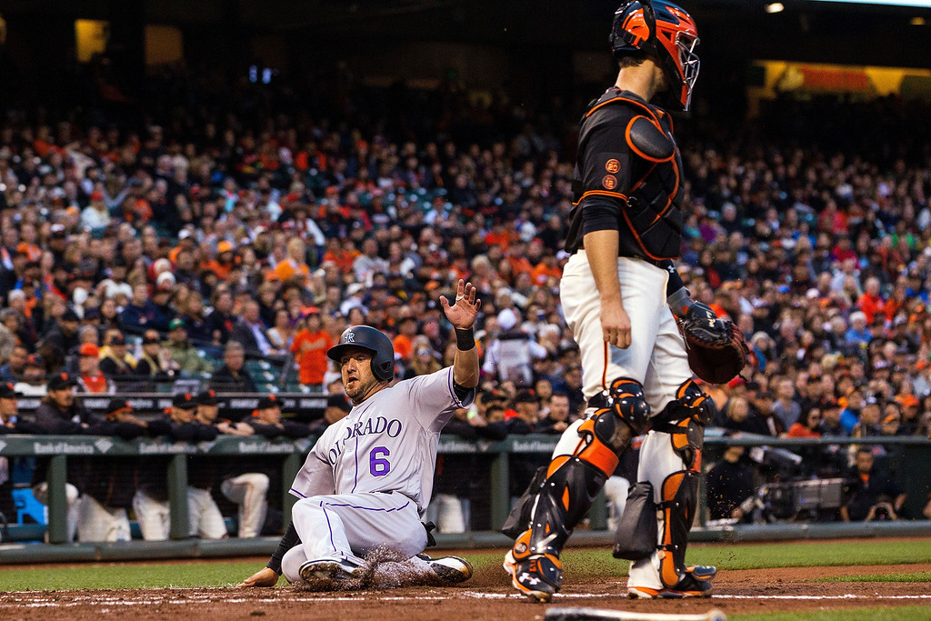 . SAN FRANCISCO, CA - MAY 06: Ryan Raburn #6 of the Colorado Rockies slides into home plate to score a run past Buster Posey #28 of the San Francisco Giants during the second inning at AT&T Park on May 6, 2016 in San Francisco, California.  (Photo by Jason O. Watson/Getty Images)