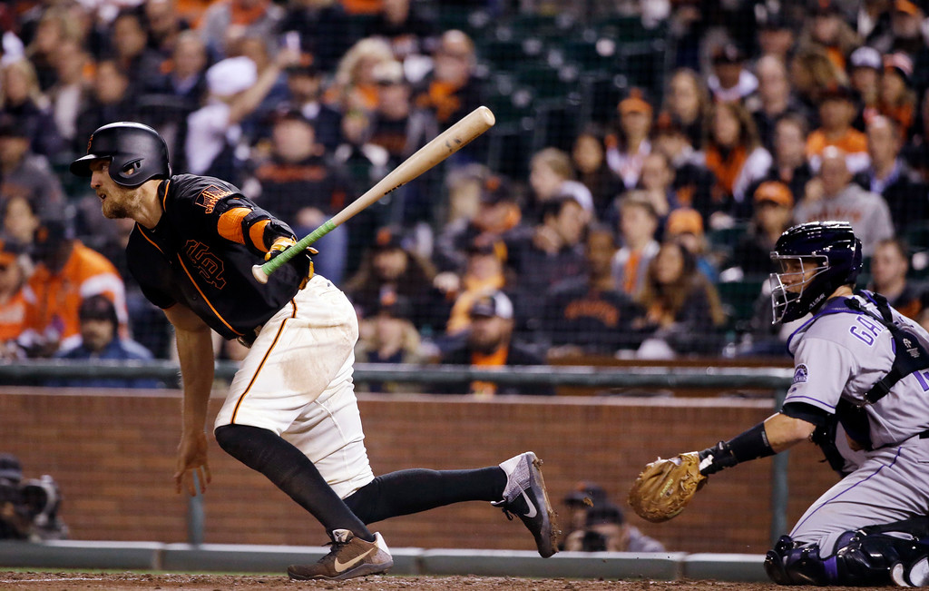 . San Francisco Giants\' Hunter Pence drives in a run with a single during the fifth inning of a baseball game against the Colorado Rockies Friday, May 6, 2016, in San Francisco. (AP Photo/Marcio Jose Sanchez)