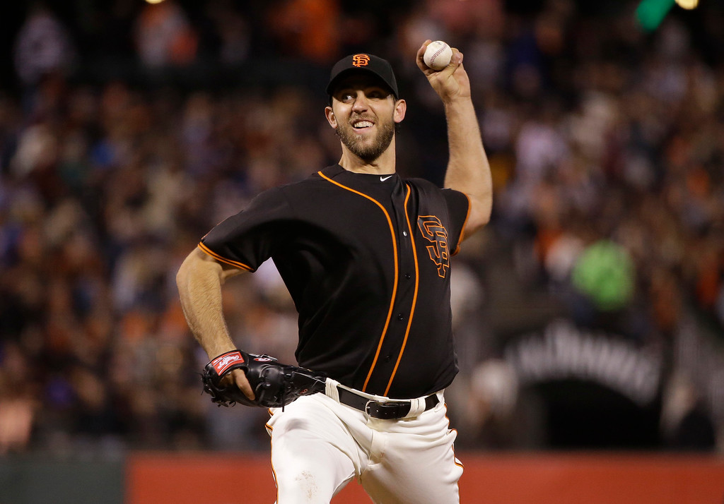 . San Francisco Giants starting pitcher Madison Bumgarner throws to the Colorado Rockies during the sixth inning of a baseball game Friday, May 6, 2016, in San Francisco. (AP Photo/Marcio Jose Sanchez)