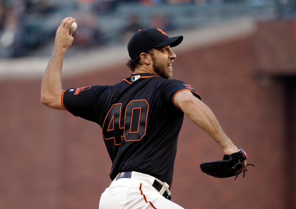. San Francisco Giants starter Madison Bumgarner throws to the Colorado Rockies during the first inning of a baseball game against the Colorado Rockies Friday, May 6, 2016, in San Francisco. (AP Photo/Marcio Jose Sanchez)