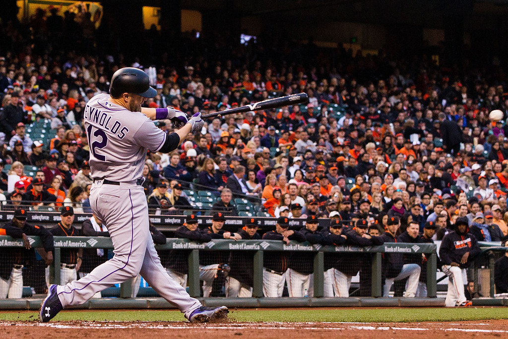 . SAN FRANCISCO, CA - MAY 06: Mark Reynolds #12 of the Colorado Rockies hits an RBI single against the San Francisco Giants during the second inning at AT&T Park on May 6, 2016 in San Francisco, California.  (Photo by Jason O. Watson/Getty Images)