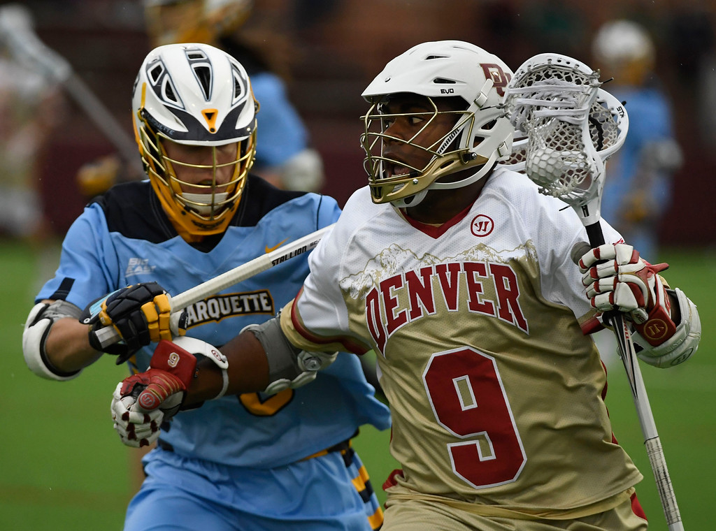 . Denver Pioneers Trevor Baptiste #9 takes the ball down field against Marquette Golden Eagles Griffin Connor #3 in the first quarter of the Big East Championship game at Peter Barton Stadium May 07, 2016. (Photo by Andy Cross/The Denver Post)