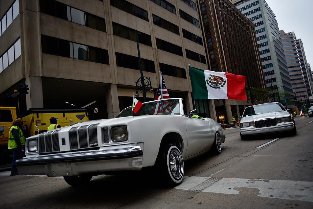 . Cars drive through downtown Denver during the parade at the start of the 29th Annual Cinco De Mayo Celebration at Civic Center Park in downtown Denver, Colorado, Saturday, May 7, 2016. Festivities were hampered by afternoon showers and some hail on Saturday, however festivities will continue on Sunday. (Brenden Neville/Special to the Denver Post)