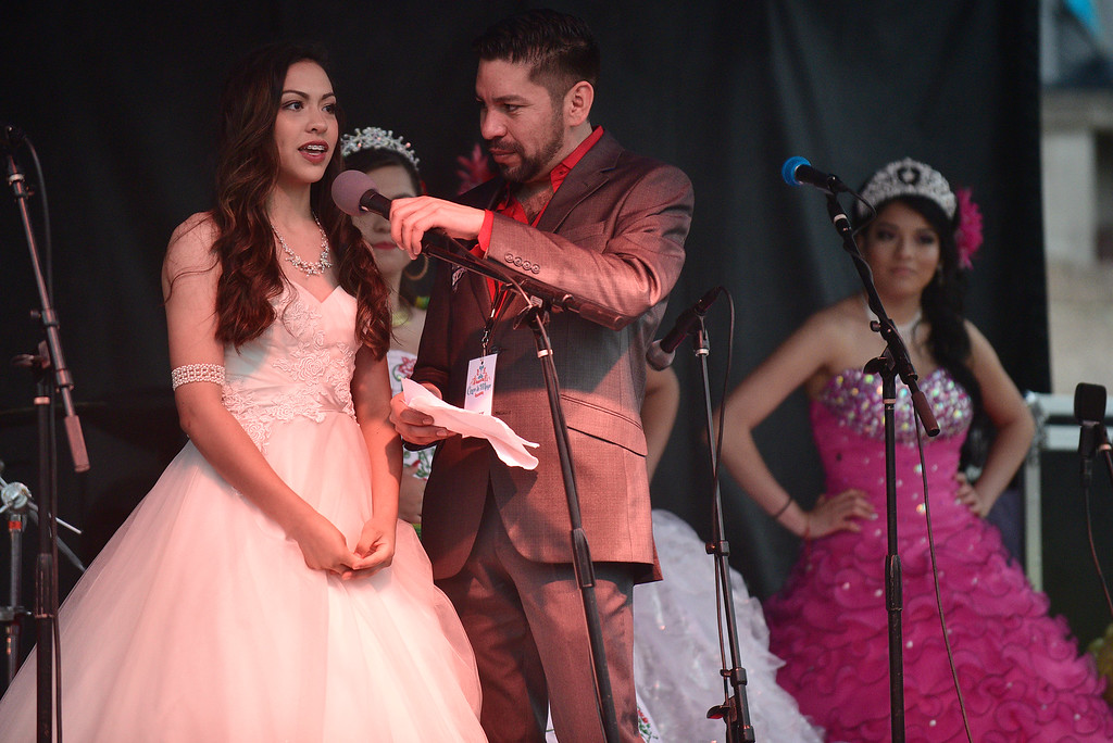 . Fabiola Sera, 14, is interviewed by Ramiro Varela during the Quinceanera Fashion Show at the 29th Annual Cinco De Mayo Celebration at Civic Center Park in downtown Denver, Colorado, Saturday, May 7, 2016. Festivities were hampered by afternoon showers and some hail on Saturday, however festivities will continue on Sunday. (Brenden Neville/Special to the Denver Post)