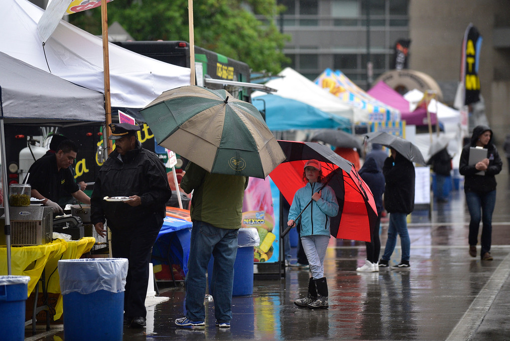 . Rain falls on visitors and vendor tents during the 29th Annual Cinco De Mayo Celebration at Civic Center Park in downtown Denver, Colorado, Saturday, May 7, 2016. Festivities were hampered by afternoon showers and some hail on Saturday, however festivities will continue on Sunday. (Brenden Neville/Special to the Denver Post)