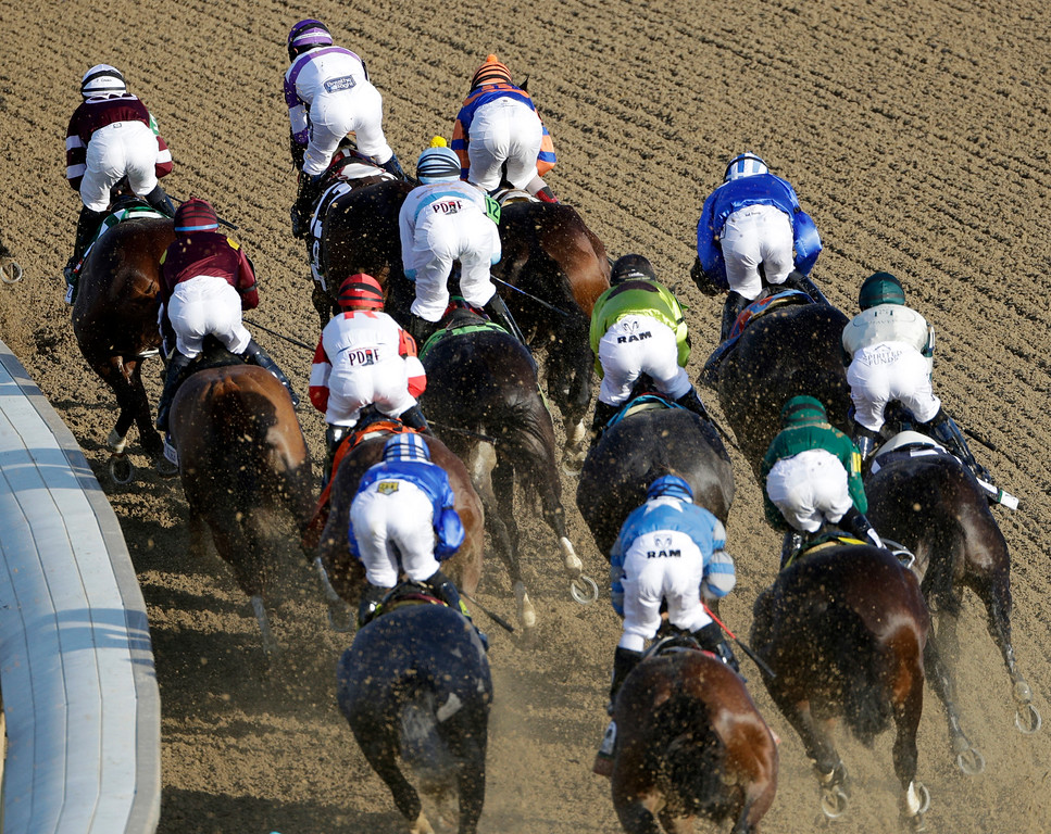 . Horses run during the 142nd running of the Kentucky Derby horse race at Churchill Downs Saturday, May 7, 2016, in Louisville, Ky. (AP Photo/Charlie Riedel)