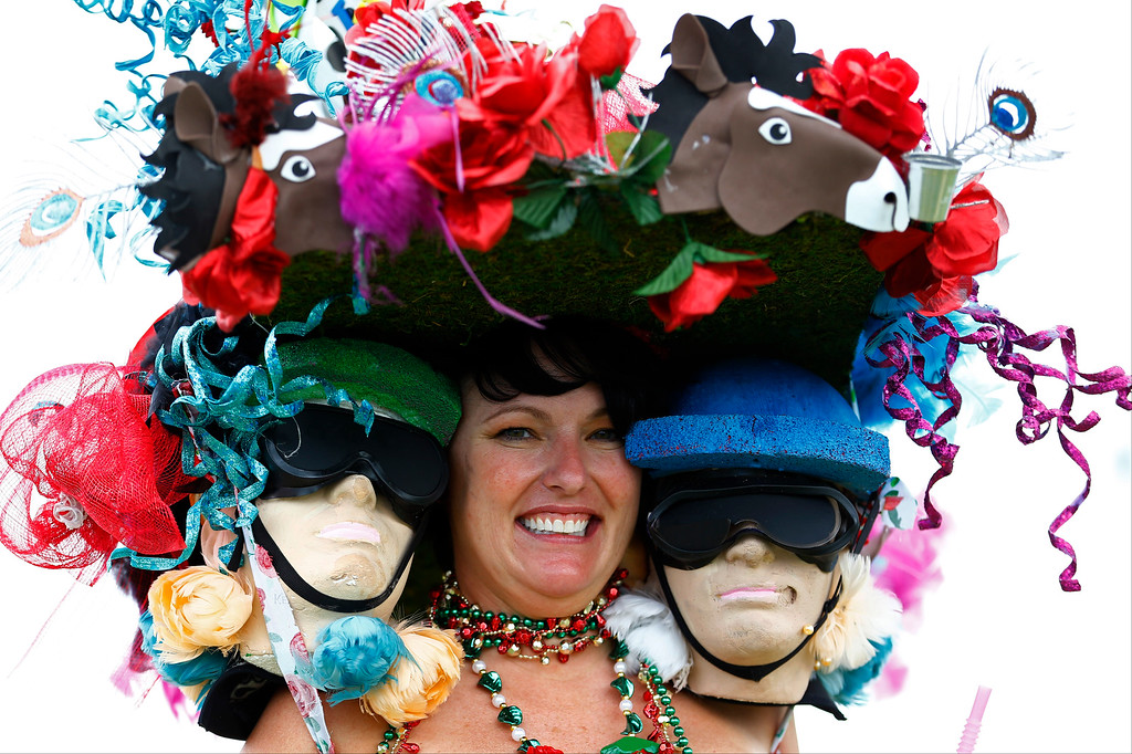 . A fan wears a hat before the 142nd running of the Kentucky Derby horse race at Churchill Downs Saturday, May 7, 2016, in Louisville, Ky. (AP Photo/Julio Cortez)