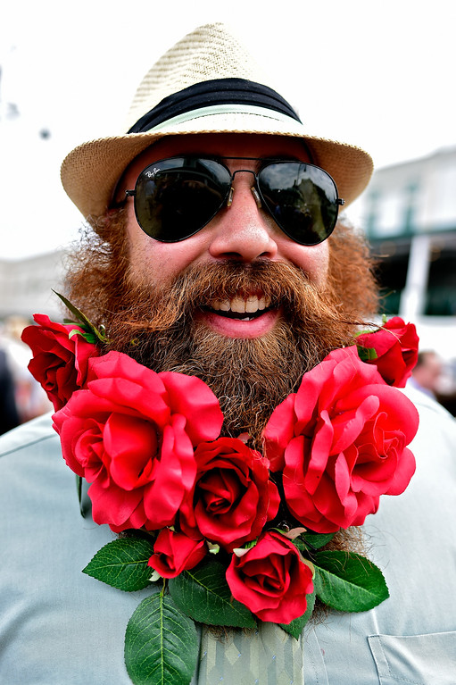 . A man wearing a festive hat and roses poses prior to the 142nd running of the Kentucky Derby at Churchill Downs on May 07, 2016 in Louisville, Kentucky.  (Photo by Logan Riely/Getty Images)