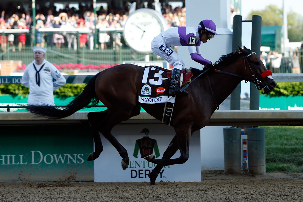 . Nyquist #13, ridden by Mario Gutierrez, crosses the finish line to win the 142nd running of the Kentucky Derby at Churchill Downs on May 07, 2016 in Louisville, Kentucky.  (Photo by Dylan Buell/Getty Images)