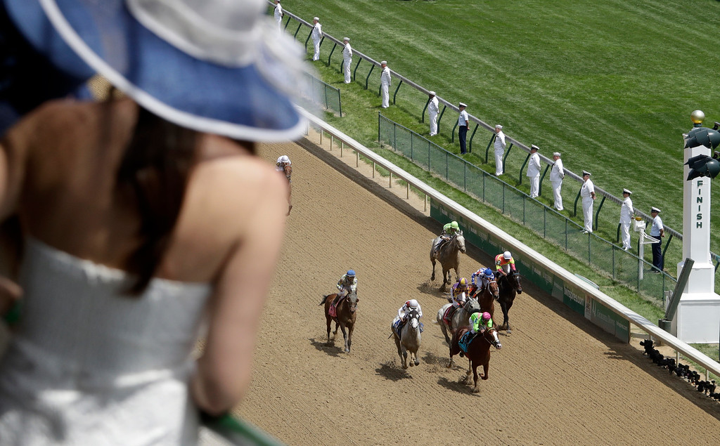 . Fans watch race from a balcony before the 142nd running of the Kentucky Derby horse race at Churchill Downs Saturday, May 7, 2016, in Louisville, Ky. (AP Photo/Charlie Riedel)