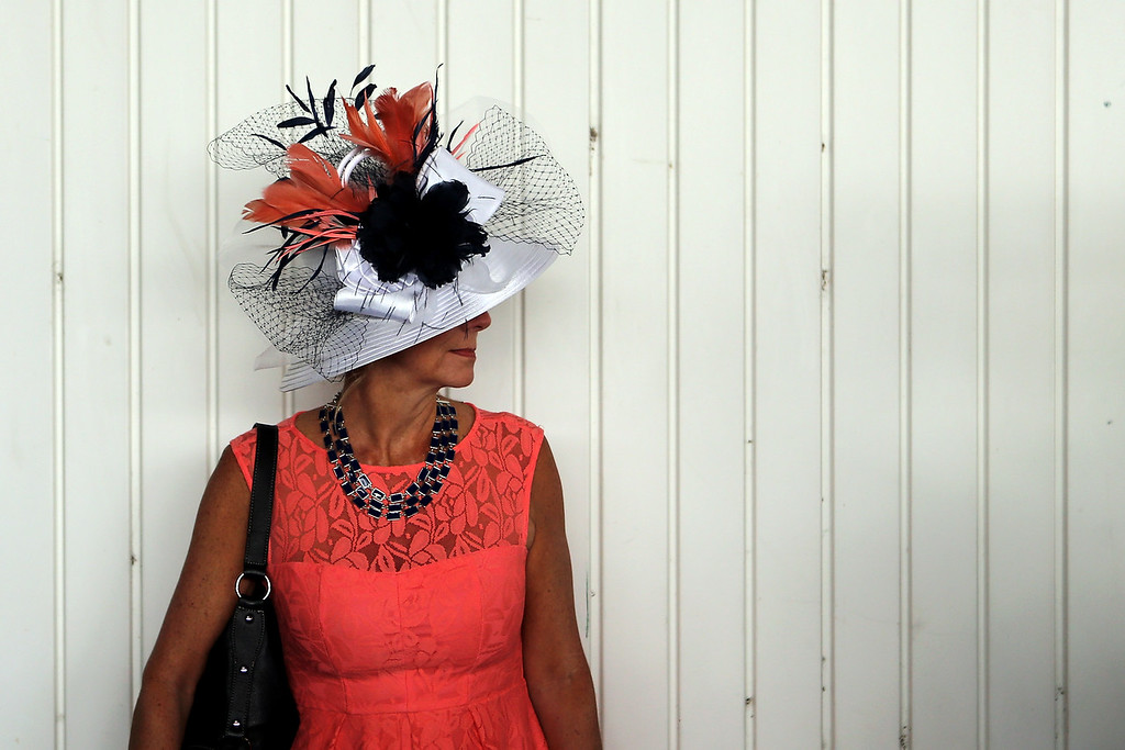 . A woman wearing a festive hat looks on prior to the 142nd running of the Kentucky Derby at Churchill Downs on May 07, 2016 in Louisville, Kentucky.  (Photo by Michael Reaves/Getty Images)