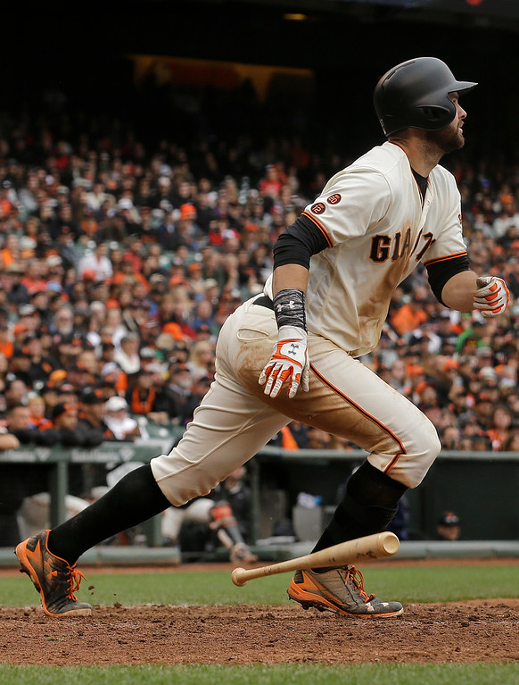 . San Francisco Giants\' Brandon Belt hits a triple against the Colorado Rockies during the tenth inning of a baseball game in San Francisco, Saturday, May 7, 2016. (AP Photo/Jeff Chiu)