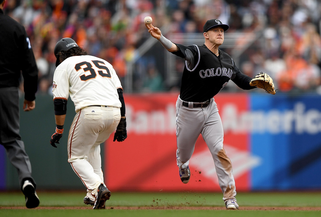 . SAN FRANCISCO, CA - MAY 07:  Trevor Story #27 of the Colorado Rockies completes the double-play over the top of Brandon Crawford #35 of the San Francisco Giants in the bottom of the eighth inning at AT&T Park on May 7, 2016 in San Francisco, California.  (Photo by Thearon W. Henderson/Getty Images)