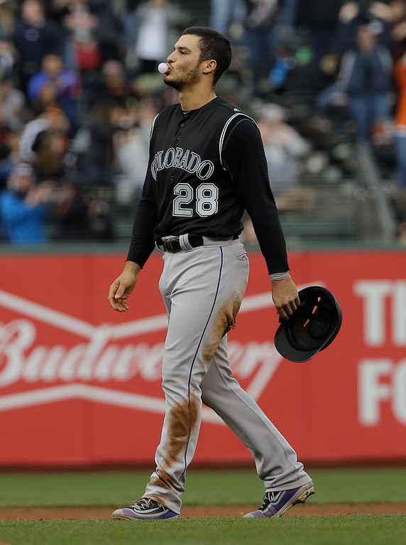 . Colorado Rockies\' Nolan Arenado (28) reacts after being called out at second base during the thirteenth inning of a baseball game against the San Francisco Giants in San Francisco, Saturday, May 7, 2016. The Giants won 2-1. (AP Photo/Jeff Chiu)