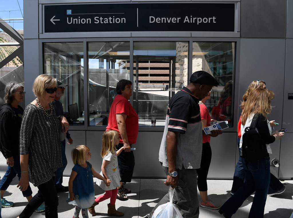 . Train passengers arrive at Denver International after taking a trip on the RTD University of Colorado A-Line train at Denver International Airport April 22, 2016. (Photo by Andy Cross/The Denver Post)