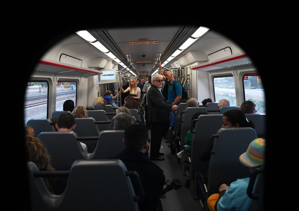 . Riders travel Denver International Airport on the new University of Colorado A-Line train, April 22, 2016. The line is 23 miles with 8 stations along the way. (Photo by RJ Sangosti/The Denver Post)
