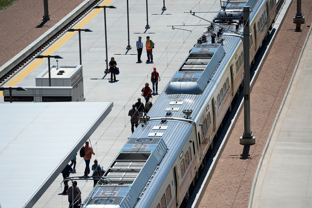 . Train passengers board the new RTD University of Colorado A-Line train at Denver International Airport on opening day April 22, 2016. (Photo by Andy Cross/The Denver Post)