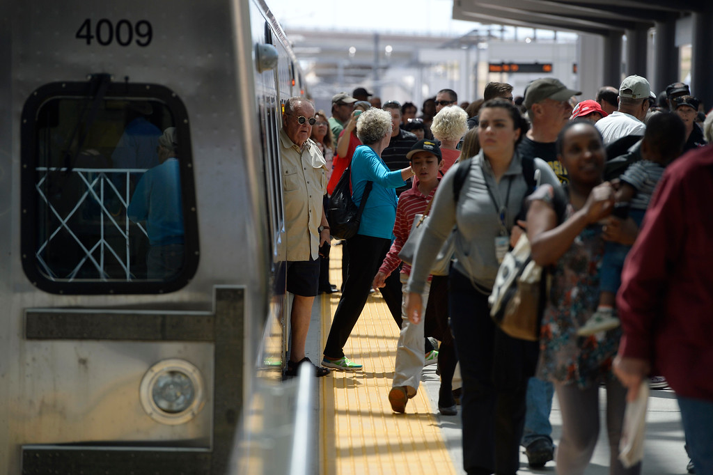 . Train passengers unload off of the new RTD University of Colorado A-Line train at Denver International Airport on opening day April 22, 2016. (Photo by Andy Cross/The Denver Post)
