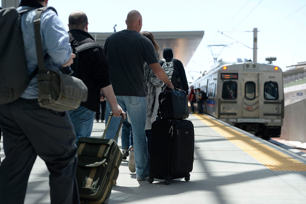 . Train passengers head to the new RTD University of Colorado A-Line train at Denver International Airport April 22, 2016. (Photo by Andy Cross/The Denver Post)