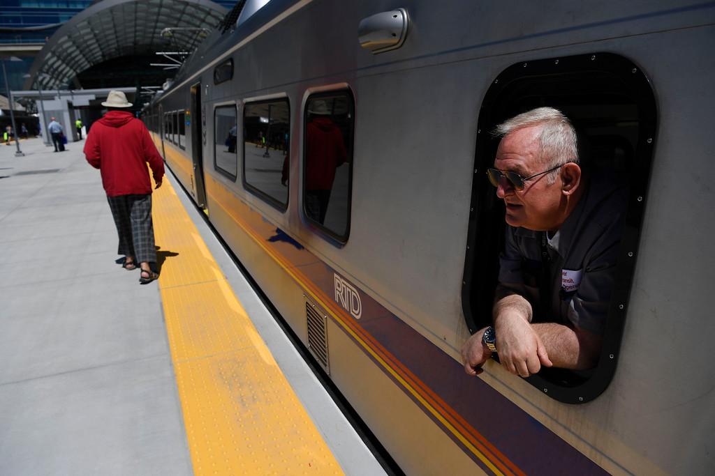 . RTD train operator Michael Stewart pokes his head out of the window moments before departing from Denver International Airport on the new RTD University of Colorado A-Line train April 22, 2016. (Photo by Andy Cross/The Denver Post)