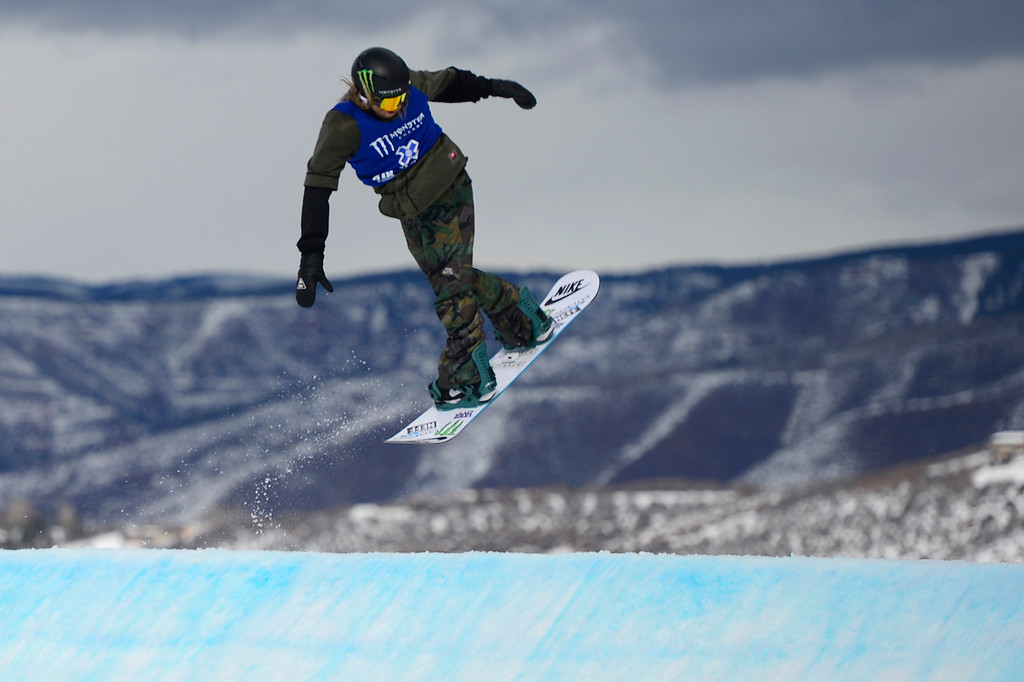 . Sage Kostenburg starts to spin going into the first jump of his second run during Snowboard Slopestyle Men\'s Final at Winter X Games 2016 at Buttermilk Mountain on January 29, 2016 in Aspen, Colorado. Mark McMorris won the event with the final score of 92.66.   (Photo by Brent Lewis/The Denver Post)