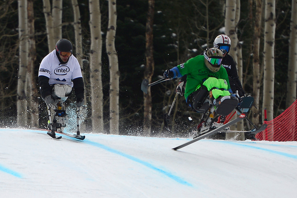 . Jerome Elbrycht crosses the finish line in front of Nikko Landeros, who took second and Kevin Bramble, of Denver, Colorado, taking third during Mono Skier X Final at Winter X Games 2016 at Buttermilk Mountain on January 29, 2016 in Aspen, Colorado.   (Photo by Brent Lewis/The Denver Post)