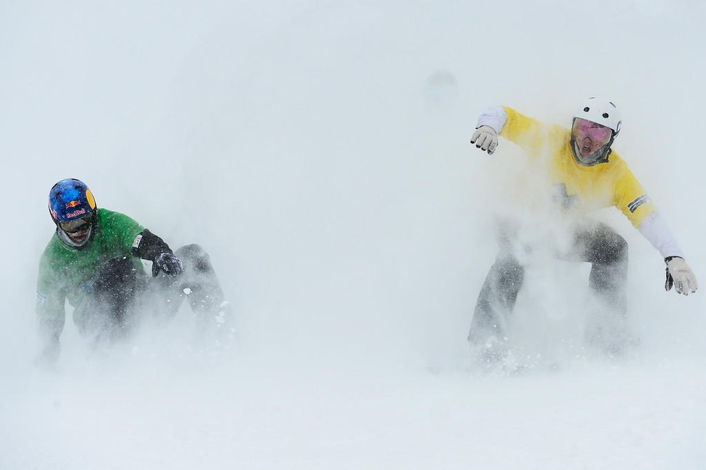 . ASPEN, CO - JANUARY 31: Jarryd Hughes, yellow, begins to celebrate after he realized that he beat out Alex Pullin, green, at the last moment for the win during the men\'s ski cross finals at Winter X Games 2016 at Buttermilk Mountain on January 31, 2016 in Aspen, Colorado. Jarryd Hughes won the event with a time of 0:59.292.  (Photo by Brent Lewis/The Denver Post)