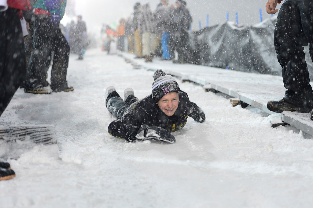 . A fan slides down the walkway on the halfpipe during men\'s halfpipe finals at Winter X Games 2016 at Buttermilk Mountain on January 29, 2016 in Aspen, Colorado. The event was canceled after the first set of runs due to weather. Matt Ladley, from Steamboat Springs, Colorado, took the gold with a score of 82.33 after finishing one run. (Photo by Brent Lewis/The Denver Post)