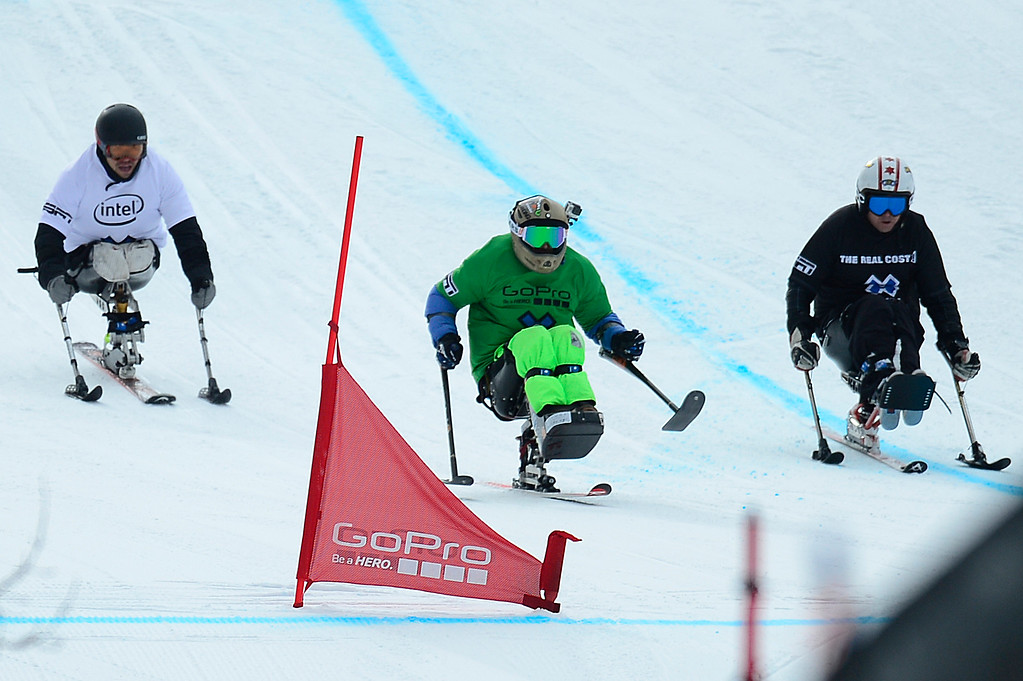 . Jerome Elbrycht, green, leads, Nikko Landeros, in black, and Kevin Bramble, in white, of Denver, Colorado, while heading into the last turn during Mono Skier X Final at Winter X Games 2016 at Buttermilk Mountain on January 29, 2016 in Aspen, Colorado. (Photo by Brent Lewis/The Denver Post)