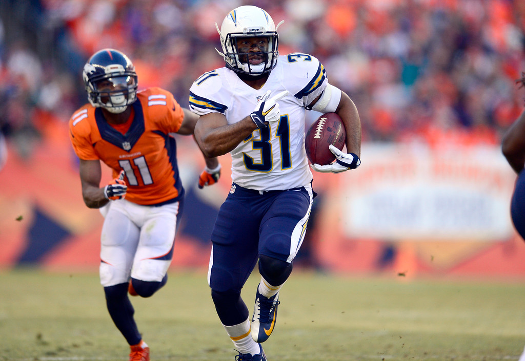 . San Diego Chargers cornerback Adrian Phillips (31) runs back an interception as Denver Broncos wide receiver Jordan Norwood (11) gives chase during the second quarter January 3, 2016 at Sports Authority Field at Mile High Stadium. (Photo By Eric Lutzens/The Denver Post)
