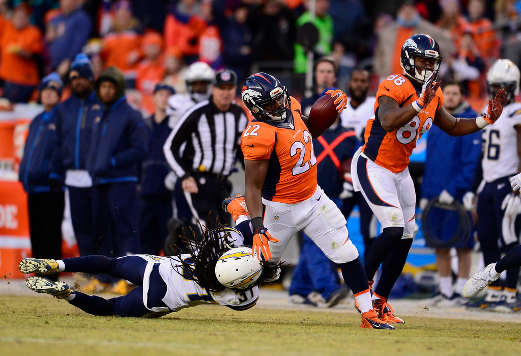 . Denver Broncos running back C.J. Anderson (22) tries to get by San Diego Chargers strong safety Jahleel Addae (37) for a gain during the third quarter January 3, 2016 at Sports Authority Field at Mile High Stadium. (Photo By Eric Lutzens/The Denver Post)