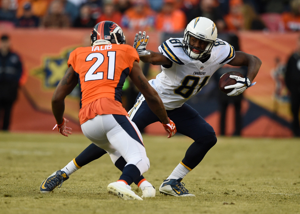 . Denver Broncos cornerback Aqib Talib (21) gets a stiff arm by San Diego Chargers wide receiver Javontee Herndon (81) after his catch during the second quarter January 3, 2016 at Sports Authority Field at Mile High Stadium. (Photo By Helen Richardson/The Denver Post)
