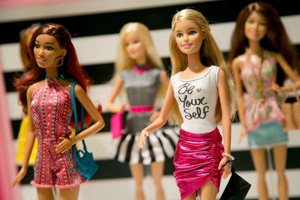 . FILE - In this Sept. 29, 2015, file photo, Barbie Fashionista Dolls from Mattel are displayed at the TTPM Holiday Showcase in New York. Mattel Inc., the maker of the famous plastic Barbie doll, says it will start selling Barbie\'s in three new body types: tall, curvy and petite. She\'ll also come in seven skin tones, 22 eye colors and 24 hairstyles. The El Segundo, Calif., toy company will also continue to sell the original Barbie.  (AP Photo/Mark Lennihan, File)
