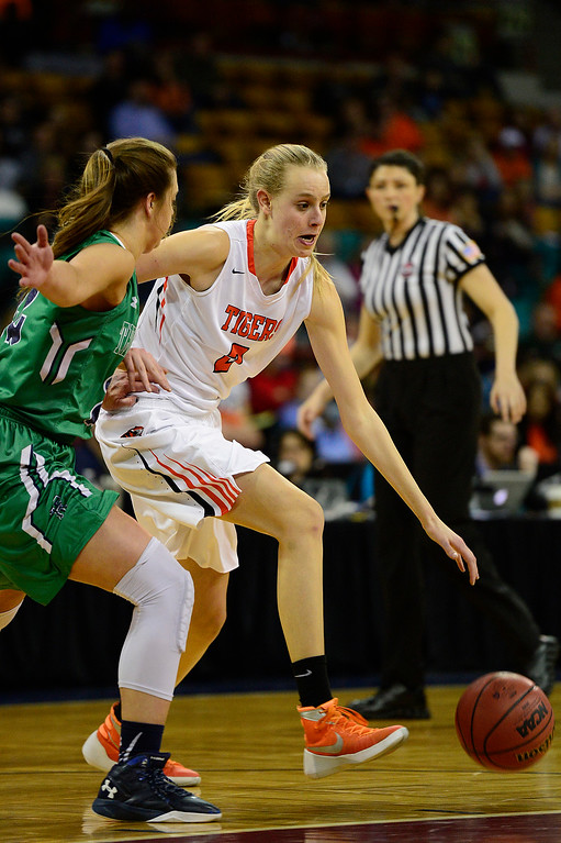 . ThunderRidge power forward Mallory Elson (22) guards Lakewood forward Camilla Emsbo (2) as she sets up a play during the second quarter at the Denver Coliseum on March 4, 2016 in Denver, Colorado. ThunderRidge took on Lakewood in the quarterfinals of girls 5A basketball tournament. (Photo by Brent Lewis/The Denver Post)