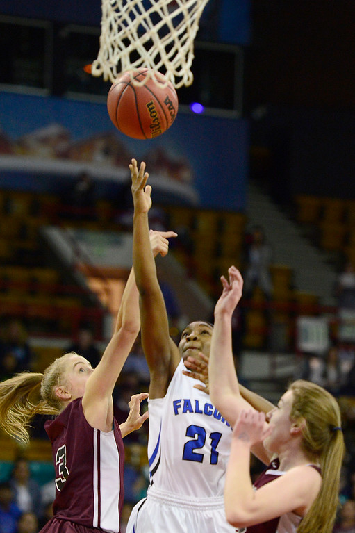 . Highlands Ranch point guard Symone Starks (21) goes for a layup during the third quarter  at the Denver Coliseum on March 4, 2016 in Denver, Colorado. Highlands Ranch defeated Horizon 65-35 to advance to the semifinals of girls 5A basketball tournament. (Photo by Brent Lewis/The Denver Post)