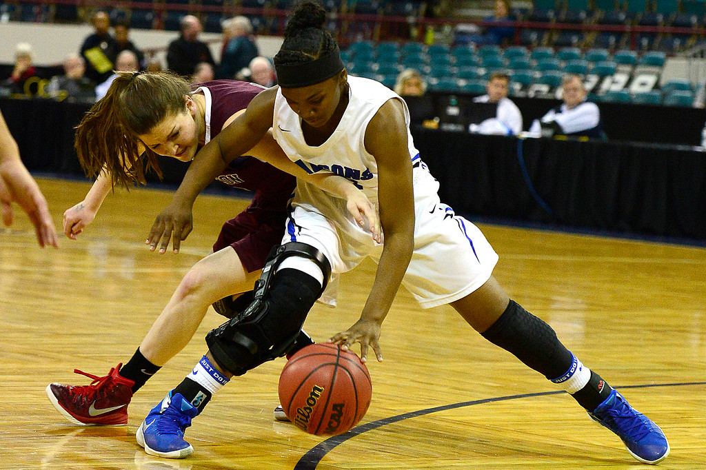 . Horizon guard Ashley Mortensen (0) tries to steal from Highlands Ranch point guard Symone Starks (21) during the third quarter at the Denver Coliseum on March 4, 2016 in Denver, Colorado. Highlands Ranch defeated Horizon 65-35 to advance to the semifinals of girls 5A basketball tournament. (Photo by Brent Lewis/The Denver Post)