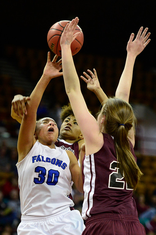 . Highlands Ranch forward Leilah Vigil (30) is defended by Horizon guard Isabella Allen (23) and Samantha Deem during the third quarter at the Denver Coliseum on March 4, 2016 in Denver, Colorado. Highlands Ranch defeated Horizon 65-35 to advance to the semifinals of girls 5A basketball tournament. (Photo by Brent Lewis/The Denver Post)