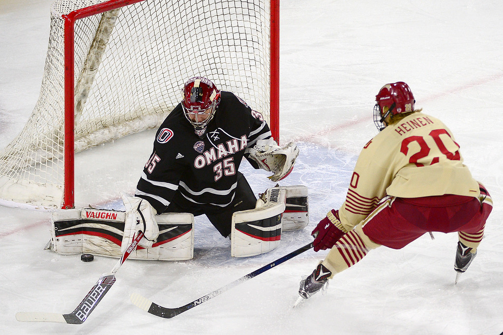 . Denver Pioneers forward Danton Heinen (20) takes a shot on Nebraska-Omaha Mavericks goalie Evan Weninger (35) during the first period at Magness Arena on March 4, 2016 in Denver, Colorado. (Photo by Brent Lewis/The Denver Post)