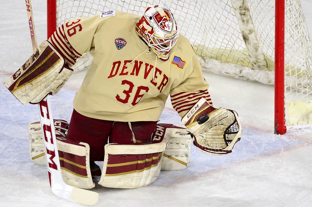 . Denver Pioneers goalie Tanner Jaillet (36) grabs the puck after a shot during the first period at Magness Arena on March 4, 2016 in Denver, Colorado. (Photo by Brent Lewis/The Denver Post)