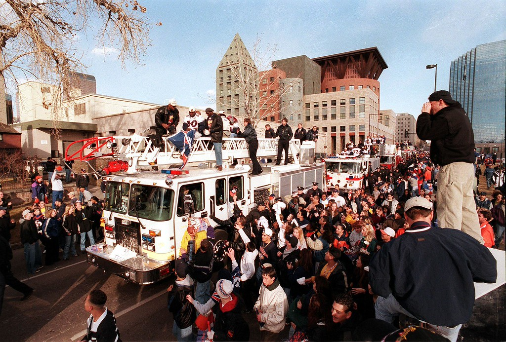 . The Super Bowl champion Denver Broncos ride atop fire trucks during their victory parade February 1, 1999, through downtown Denver. The Broncos defeated the Atlanta Falcons 34-19 in the Super Bowl. (Photo credit should read JONATHAN CASTNER/AFP/Getty Images)