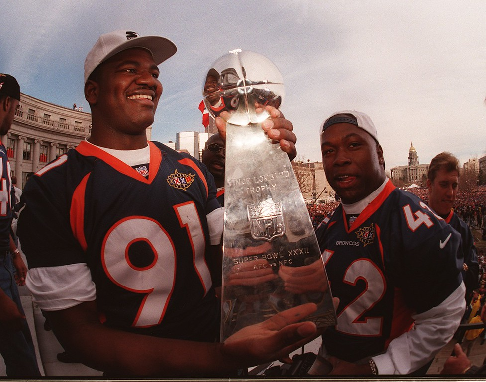 . Alfred Williams, left, and Detron smith, right, admired  the Lombardi trophy Tuesday afternoon after the parade in 1998.  (Photo by Karl Gehring/The Denver Post)