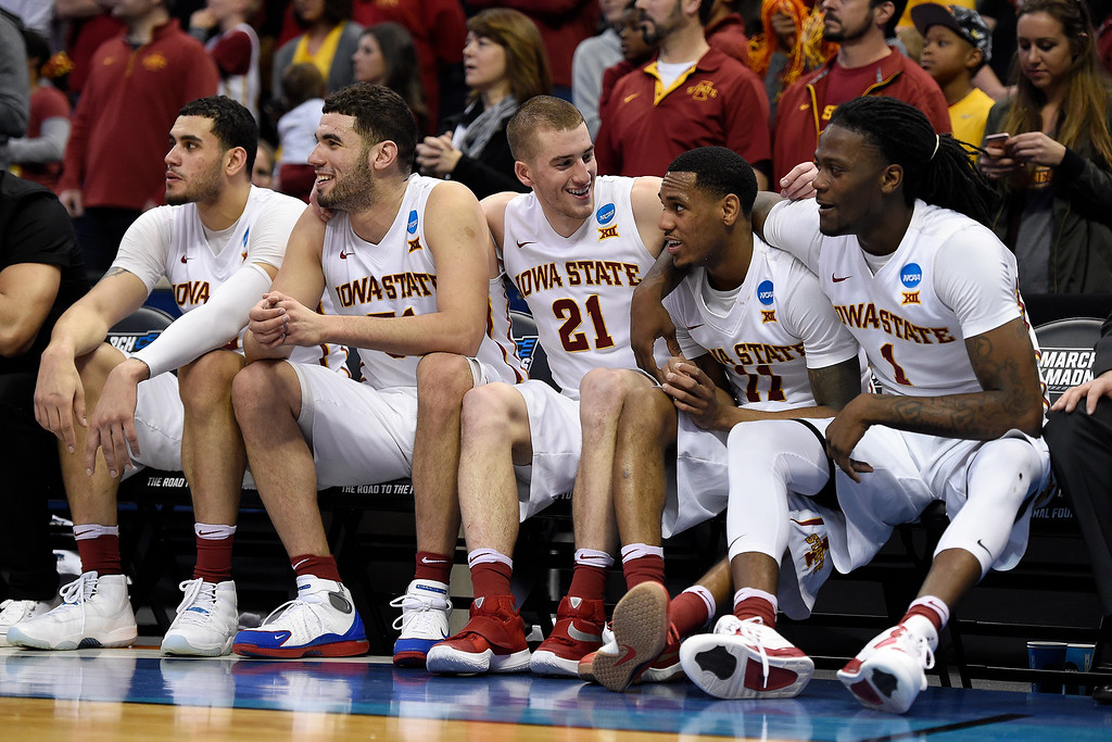 . DENVER, CO - MARCH 19: Abdel Nader (2) of the Iowa State Cyclones, Georges Niang (31), Matt Thomas (21), Monte Morris (11) and Jameel McKay (1) celebrate on the bench in the waning seconds against the Arkansas Little Rock Trojans during the second half of Iowa State\'s 78-61 second round NCAA Tournament game win on Saturday, March 19, 2016. (Photo by AAron Ontiveroz/The Denver Post)