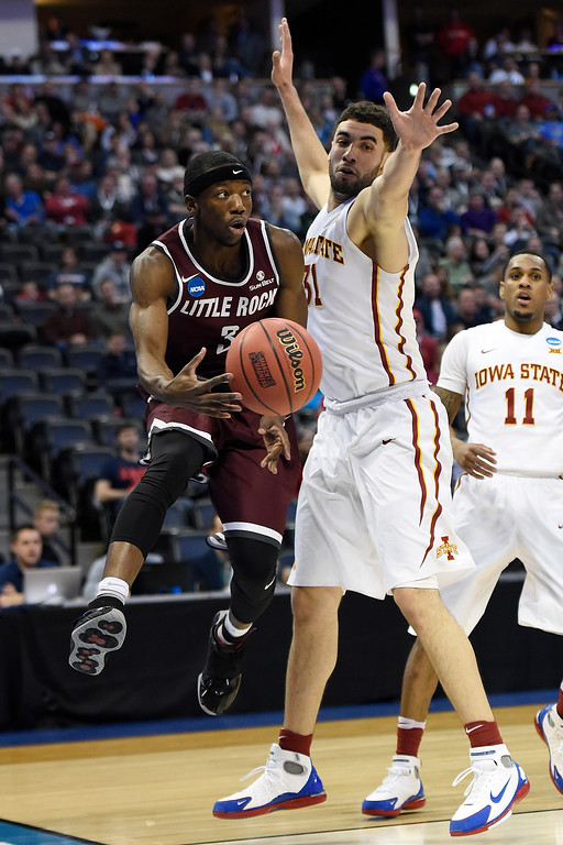 . DENVER, CO - MARCH 19: Josh Hagins (3) of the Arkansas Little Rock Trojans passes around the defense of Georges Niang (31) of the Iowa State Cyclones during the first half of their second round NCAA Tournament game on Saturday, March 19, 2016. (Photo by AAron Ontiveroz/The Denver Post)