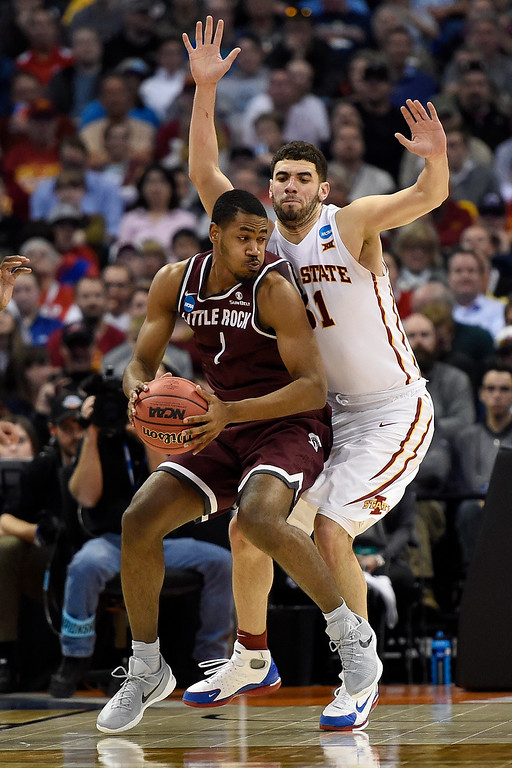 . DENVER, CO - MARCH 19: Jalen Jackson (1) of the Arkansas Little Rock Trojans gets called for traveling as Georges Niang (31) of the Iowa State Cyclones defends during the second half of Iowa State\'s 78-61 second round NCAA Tournament game win on Saturday, March 19, 2016. (Photo by AAron Ontiveroz/The Denver Post)