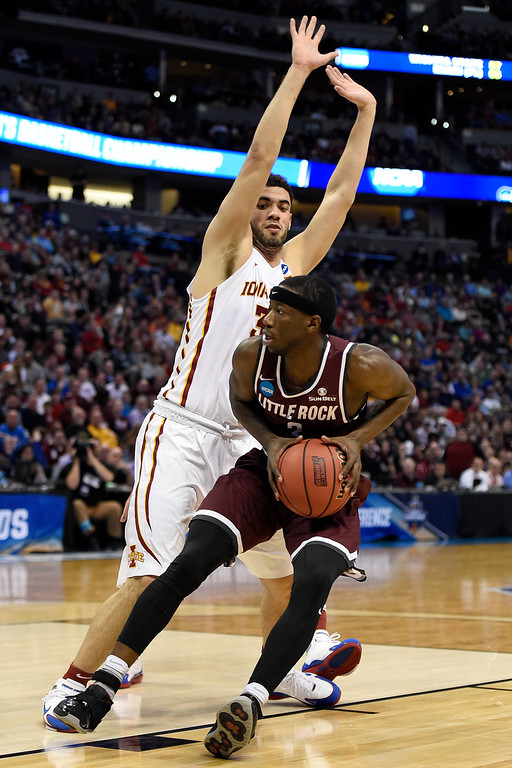 . DENVER, CO - MARCH 19: Josh Hagins (3) of the Arkansas Little Rock Trojans drives on Georges Niang (31) of the Iowa State Cyclones during the first half of their second round NCAA Tournament game on Saturday, March 19, 2016. (Photo by AAron Ontiveroz/The Denver Post)